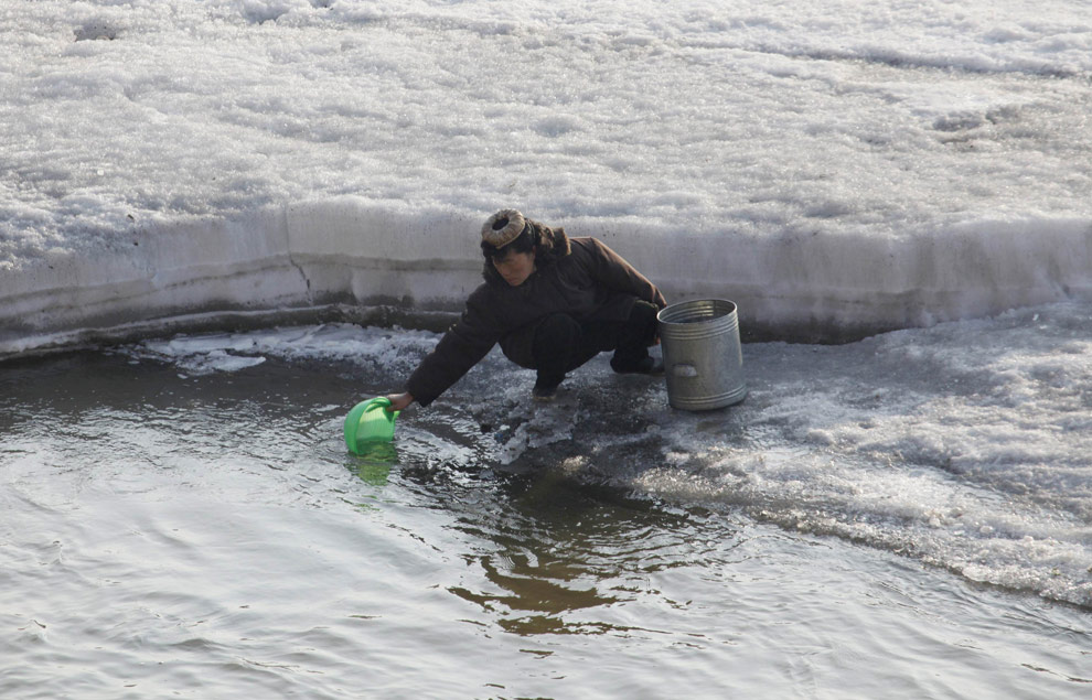Gathering Water From Icy Yalu River
